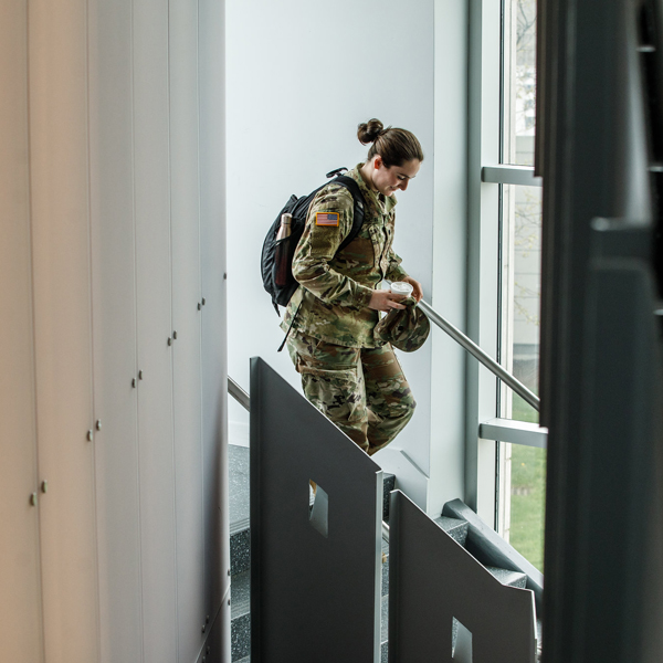 girl in army uniform in the library