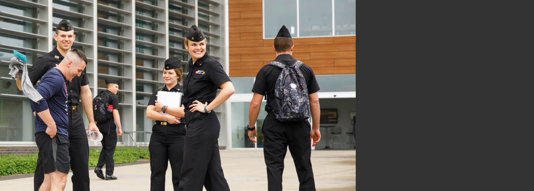 cadets smiling on campus